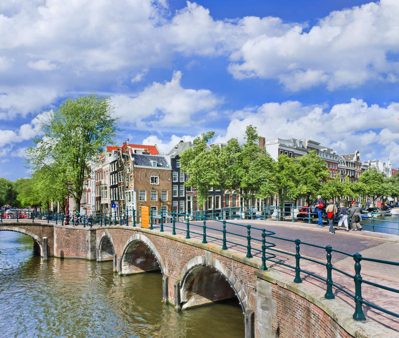 Amsterdam canal belt with ancient bridge and step gabled mansions, Amsterdam, Netherlands stock photography