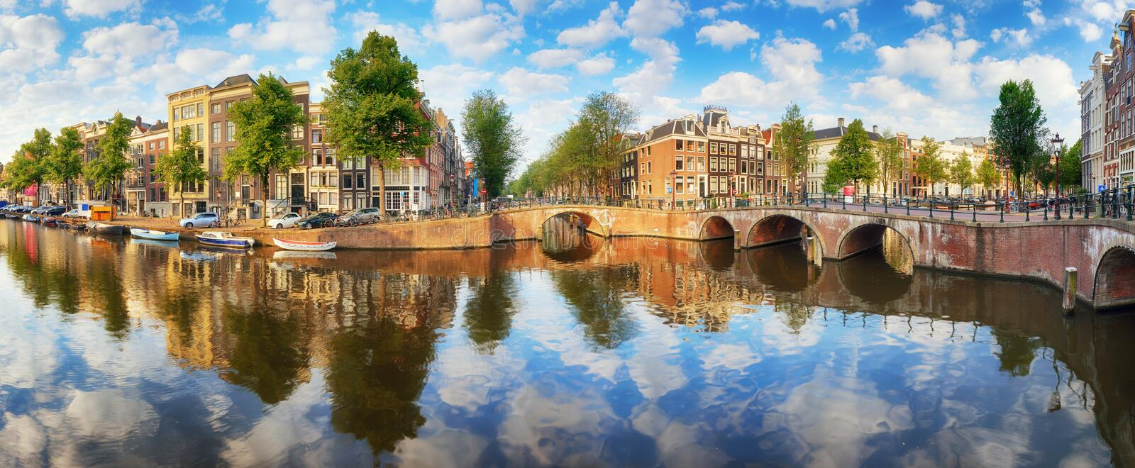Amsterdam Canal houses vibrant reflections, Netherlands, panora stock photography