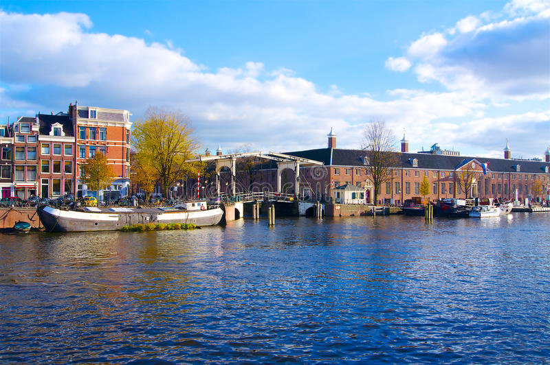 Amsterdam canal river with bridge in autumn Netherlands. Europe stock photos