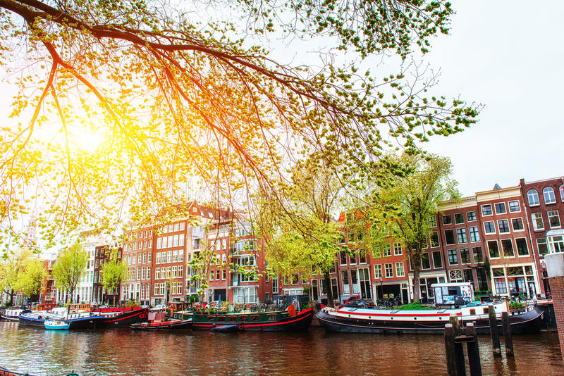 Amsterdam canal at sunset. Amsterdam is the capital and most populous city in Netherlands stock images