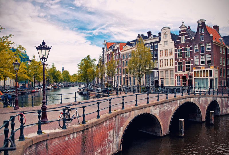 Amsterdam canals. Beautiful view of Amsterdam canals with bridge and typical dutch houses. Holland