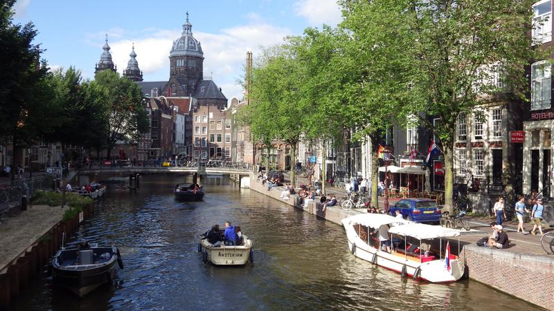 Amsterdam canals with boats, Netherlands stock photography