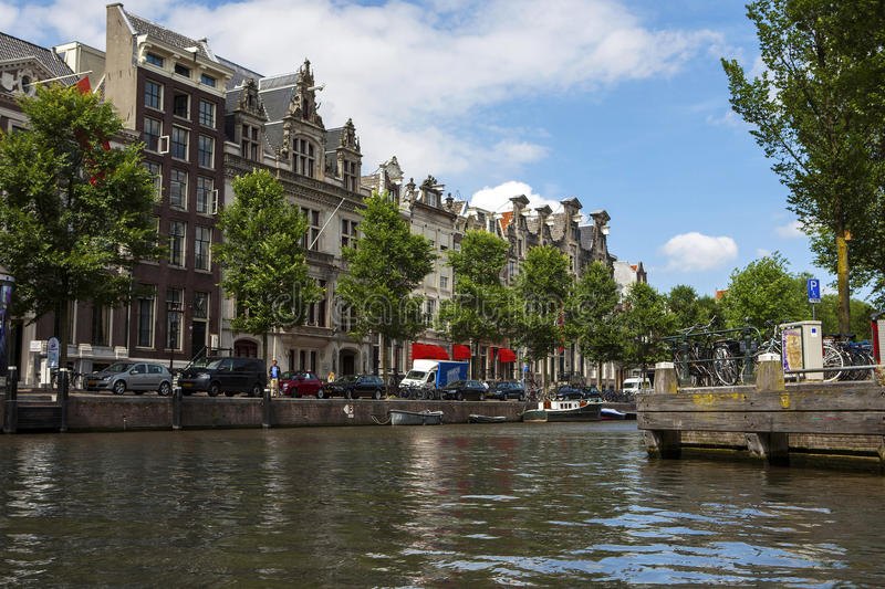 Amsterdam canals with bridges, boats and houses stock photos