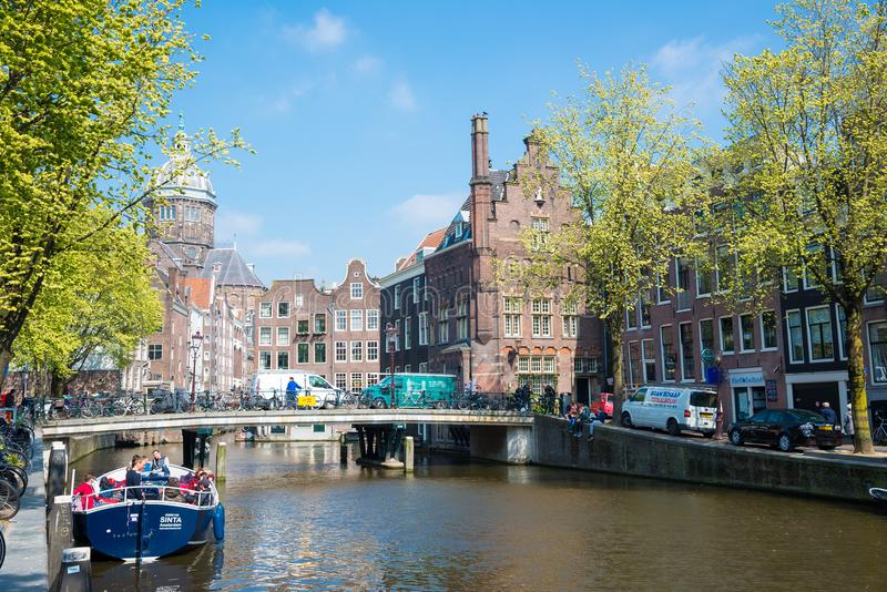 Amsterdam canals with bridges, boats and typical Dutch houses, Netherlands. royalty free stock photo