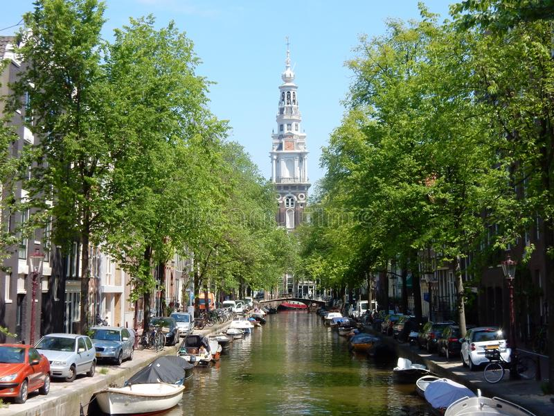 Amsterdam center - canal Groenburgwal with church Zuiderkerk. Amsterdam center - canal Groenburgwal with old church monument Zuiderkerk, Renaissance style with royalty free stock photo