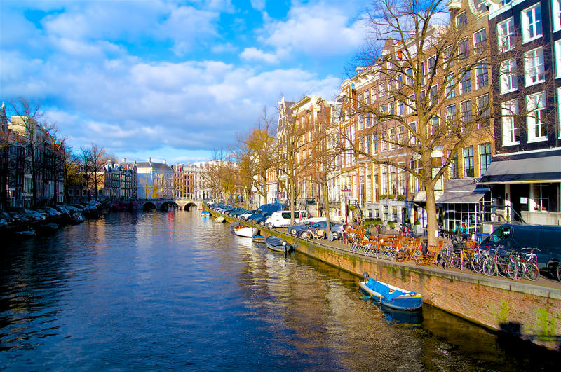 Amsterdam channel with ships in Autumn. Netherlands royalty free stock image