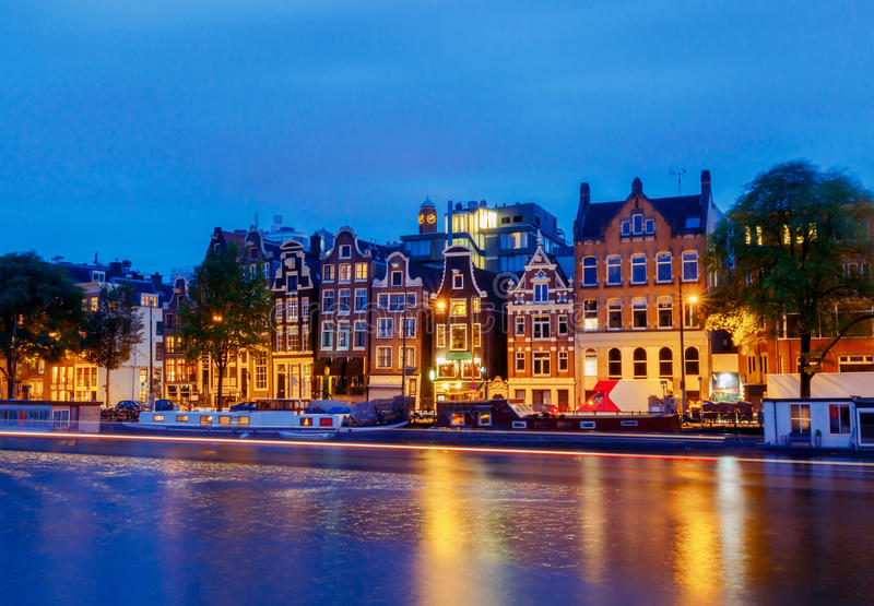 Amsterdam. City Canal at dawn. City Canal with glowing lights early in the morning. Amsterdam. Netherlands royalty free stock photo