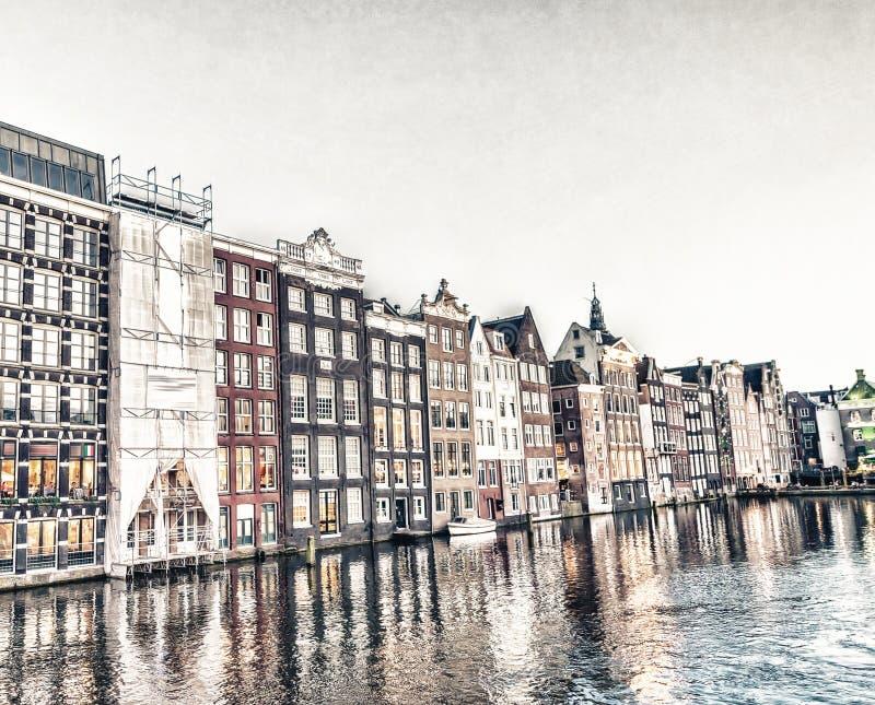 Amsterdam city homes at dusk along canal royalty free stock photography