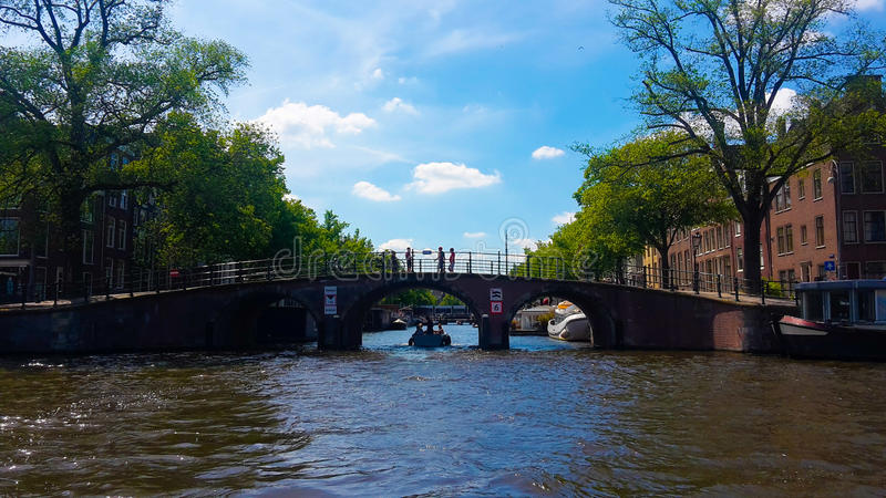Amsterdam bridge by canal royalty free stock photography