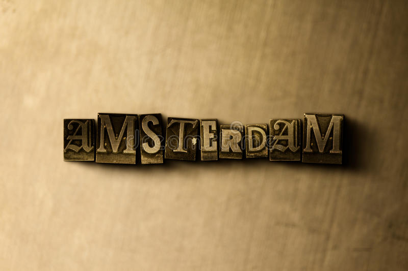 AMSTERDAM - close-up of grungy vintage typeset word on metal backdrop vector illustration