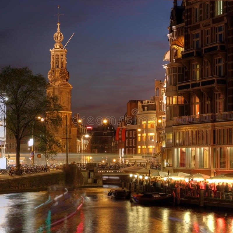 Amsterdam corner at night, The Netherlands. Munttoren is one of the old defensive towers of the medieval fortress which survive to this day. Behind it is one of stock image