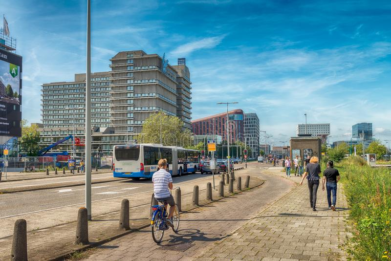 Traffic in streets of amsterdam, cars, bus, Bicycles, zuidas in Amsterdam, luxery apartments, living, houses, VU MC. Amsterdam, De Boelelaan, The Netherlands, 08 stock photo
