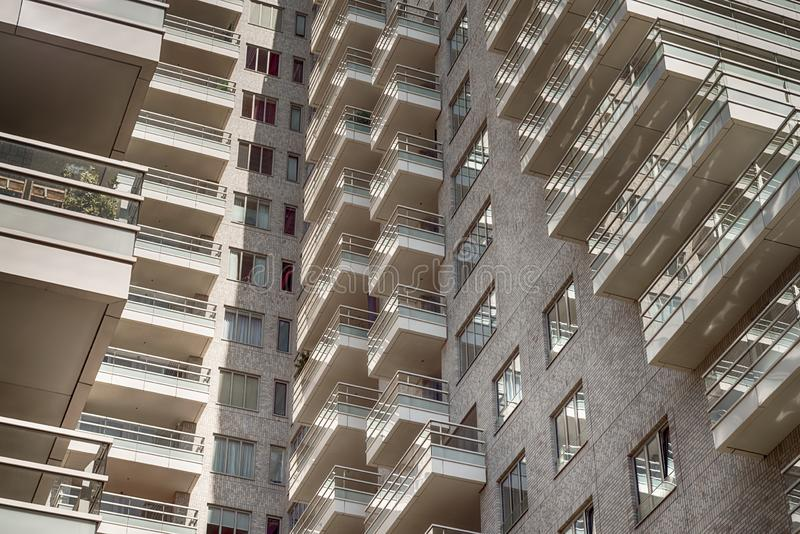 Close up, multiple balconies, luxery apartments at the zuidas in Amsterdam. Amsterdam, George Gershwinlaan, The Netherlands, 08/23/2019, Modern apartments at the royalty free stock photos