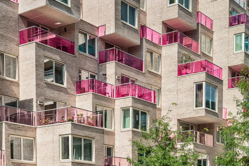 Multiple pink glass blocked balconies, apartments at the zuidas in Amsterdam, luxery apartments, living, houses. Amsterdam, George Gershwinlaan, The Netherlands stock image