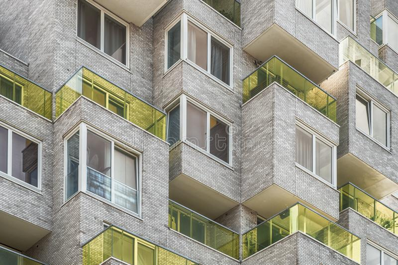 Multiple yellow glass blocked balconies, apartments at the zuidas in Amsterdam, luxery apartments, living, houses. Amsterdam, George Gershwinlaan, The royalty free stock image
