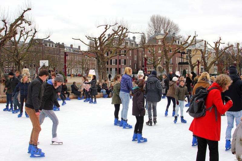 Ice skating at Museumplein in the city centre of Amsterdam, Netherlands royalty free stock photos