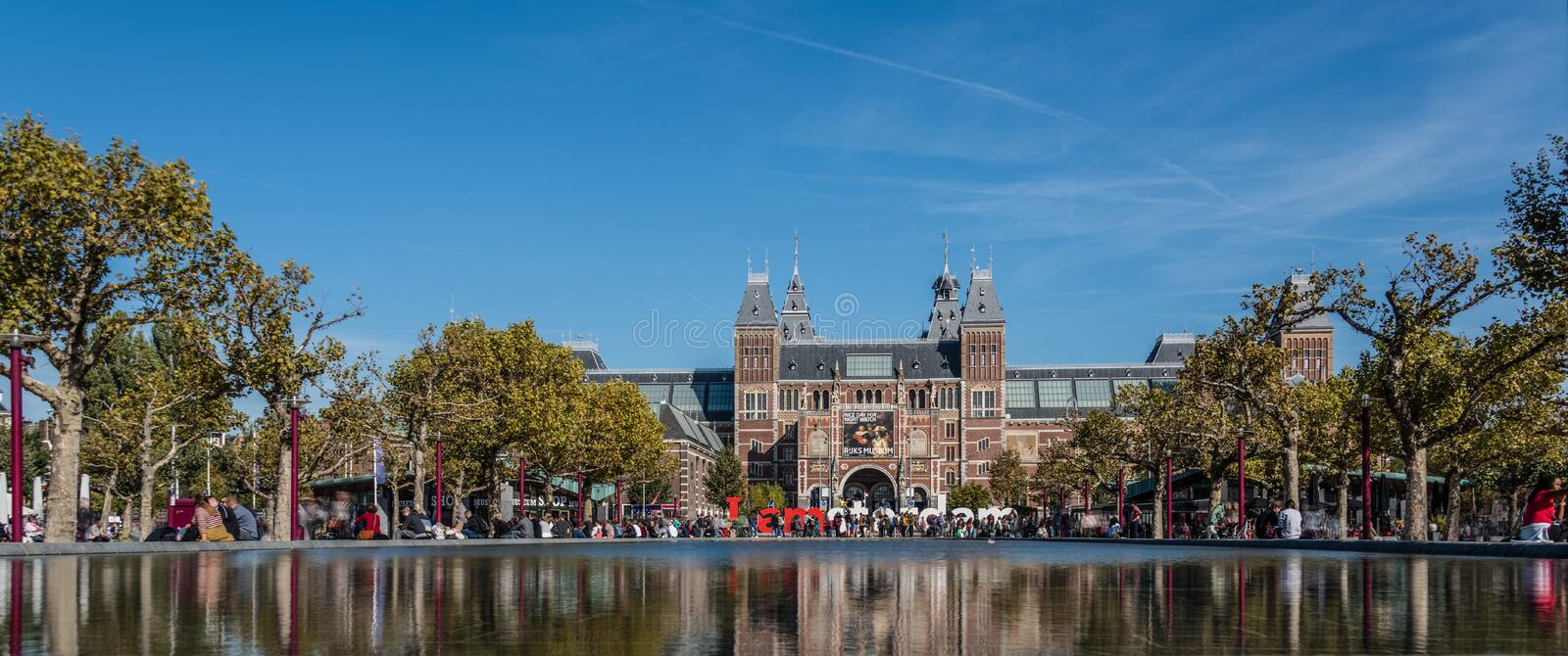 Amsterdam,  Holland, August 2019, Rijksmuseum shot at low angle reflecting in the water in the pond in front of the I Amsterdam stock photography