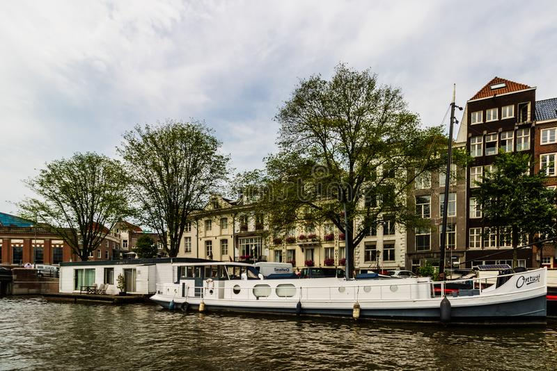 Amsterdam, Holland - 2019. Canals of Amsterdam, Netherlands in a cloudy summer day stock images