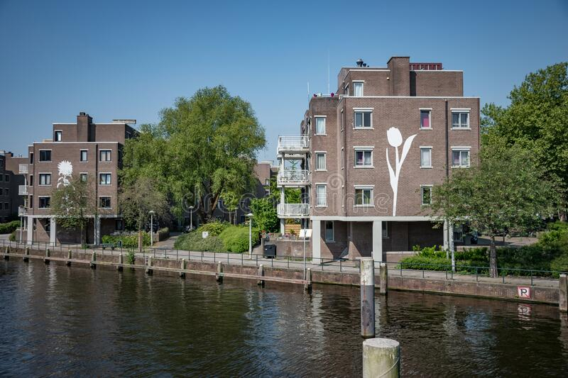 Amsterdam in Holland with its magnificent brunch breakfast canals, its levi barge bridge and traditional boat, flowery city. In europ beautiful capital stock images