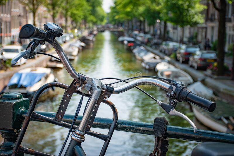 Amsterdam in Holland with its magnificent brunch breakfast canals, its levi barge bridge and traditional boat, flowery city bike. Amsterdam in Holland with its royalty free stock photos
