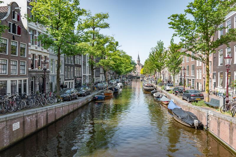 Amsterdam in Holland with its magnificent brunch breakfast canals, its levi barge bridge and traditional boat, flowery city bike. Amsterdam in Holland with its royalty free stock photo
