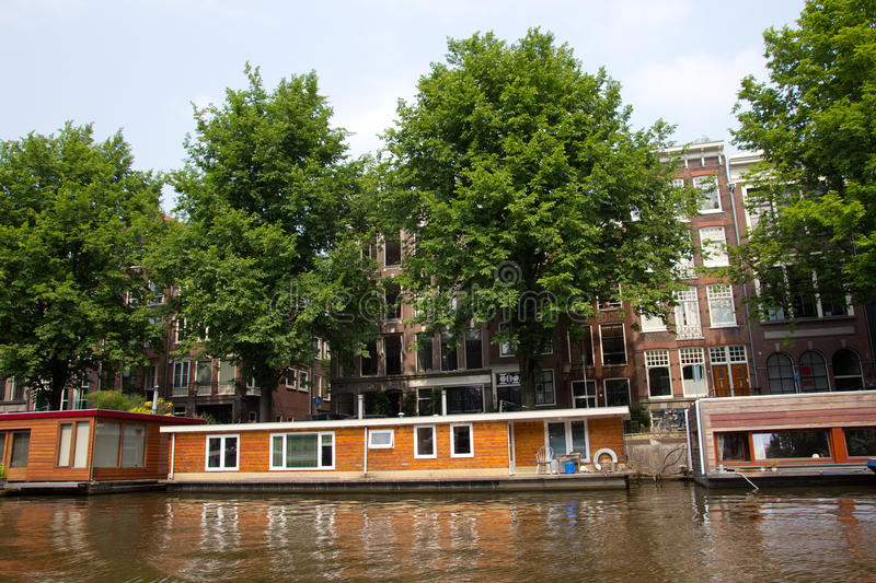 Amsterdam living boat. AMSTERDAM-JUL 27, 2012. Living boat on Jul 27, 2012 in Amsterdam. There are around 2,500 houseboats along 165 canals where locals live stock images