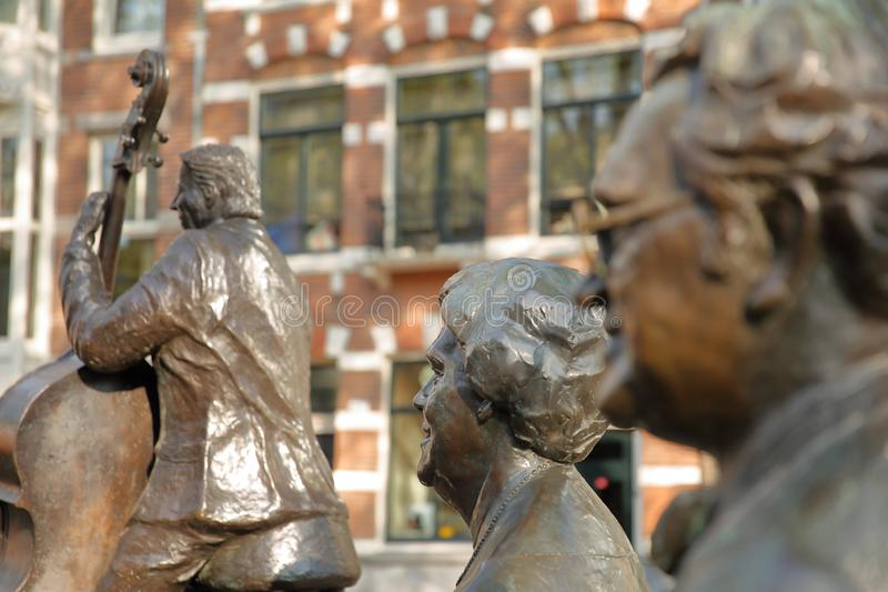 Bronze Sculptures of famous Dutch musicians and singers Johnny Meyer, Johnny Jordaan and Manke Nelis, located on Elandsgracht c stock image