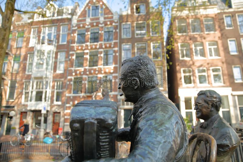 Bronze Sculptures of famous Dutch musicians and singers, located on Elandsgracht close to Prinsengracht canal. AMSTERDAM, NETHERLANDS - APRIL 05, 2019: Bronze royalty free stock photo