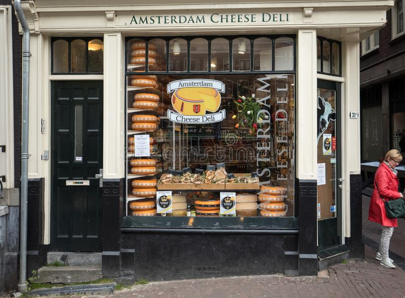Cheese wheels in Amsterdam store. Netherlands. Amsterdam, Netherlands - April 20, 2017: Cheese wheels in Amsterdam store. Netherlands royalty free stock photography