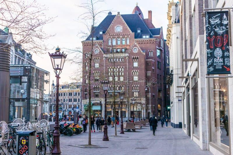 AMSTERDAM, NETHERLANDS - APRIL 12, 2019: Amsterdam city center. Beautiful street in Netherland royalty free stock image