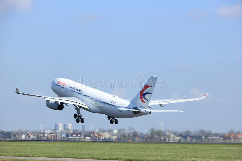 Amsterdam the Netherlands - April 2nd, 2017: B-5975 China Eastern Airlines. Airbus A330 takeoff from Polderbaan runway, Amsterdam Airport Schiphol stock photography