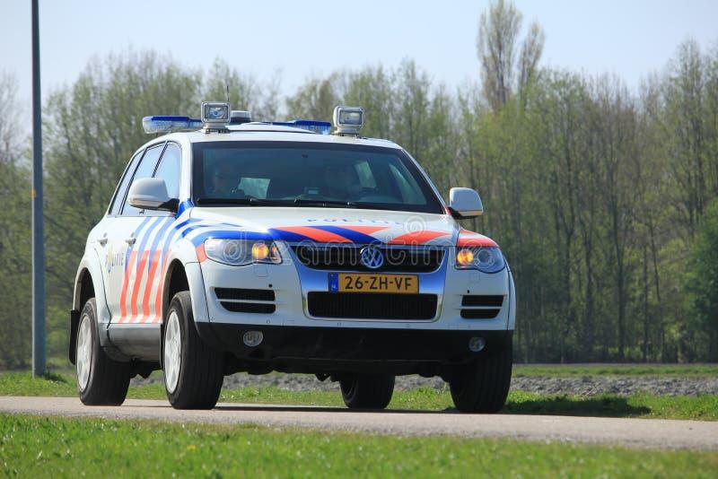 Amsterdam, the Netherlands: April 2nd 2017: Dutch police car. On surveillance near Polderbaan runway Amsterdam Airport Schilhol stock photos