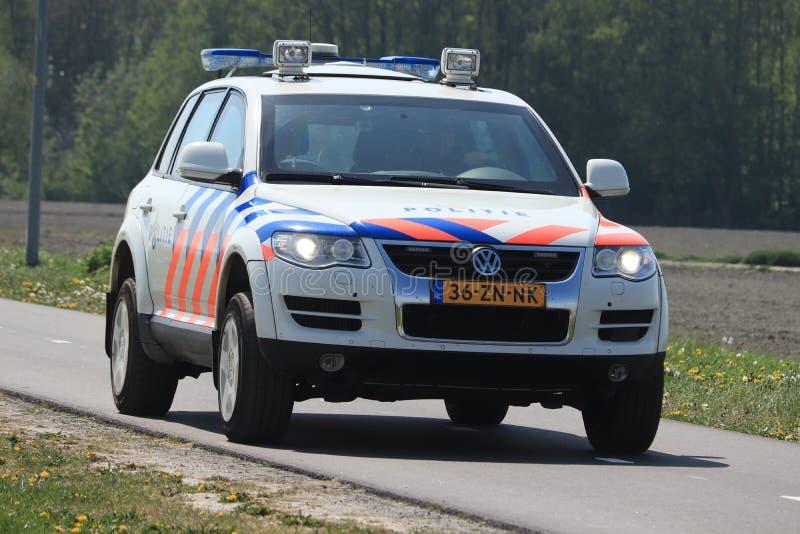 Amsterdam, the Netherlands: April 22nd 2019: Dutch police car. On surveillance near Polderbaan runway Amsterdam Airport Schiphol stock image