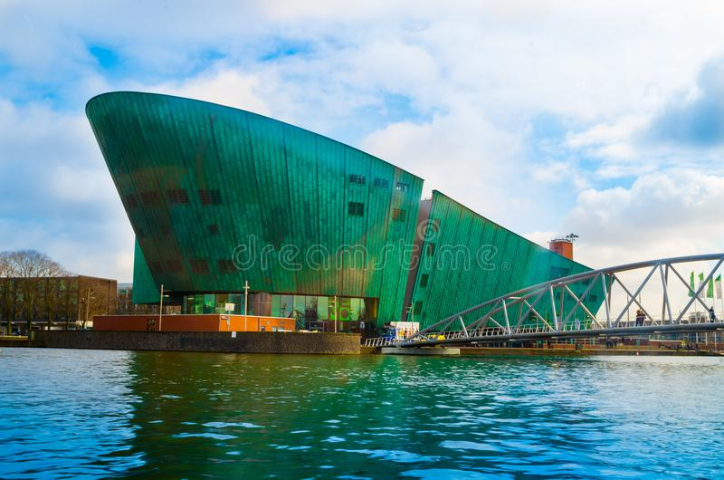 AMSTERDAM, NETHERLANDS, APRIL, 23 2018: NEMO Science Museum building is in the form of a green ship, was designed by stock photos