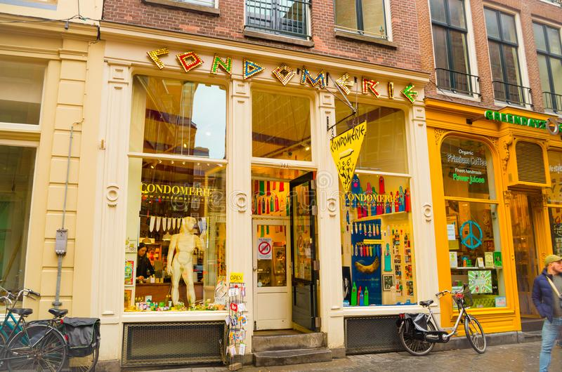 AMSTERDAM, NETHERLANDS, APRIL, 23 2018: Outdoor view of street full of commercial buildings, with restaurants, salons. And jewelry stores in a cloudy day in royalty free stock images
