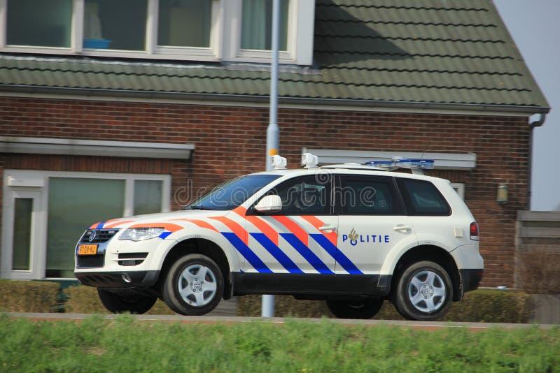 Amsterdam, the Netherlands: April 7th 2018: Dutch police car. On surveillance near Zwanenburg runway Amsterdam Airport Schilhol royalty free stock images