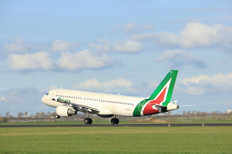 Amsterdam the Netherlands - April 7th, 2017: EI-DSL Alitalia Airbus A320. Takeoff from Polderbaan runway, Amsterdam Airport Schiphol royalty free stock photo