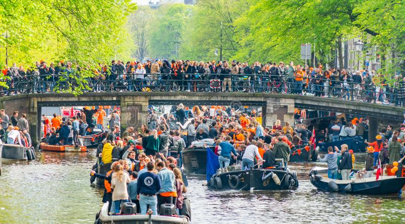 Amsterdam, The Netherlands, April 27 2018, Tourists and locals s. Ailing on the Prinsengracht to celebrate Kingsday stock photos