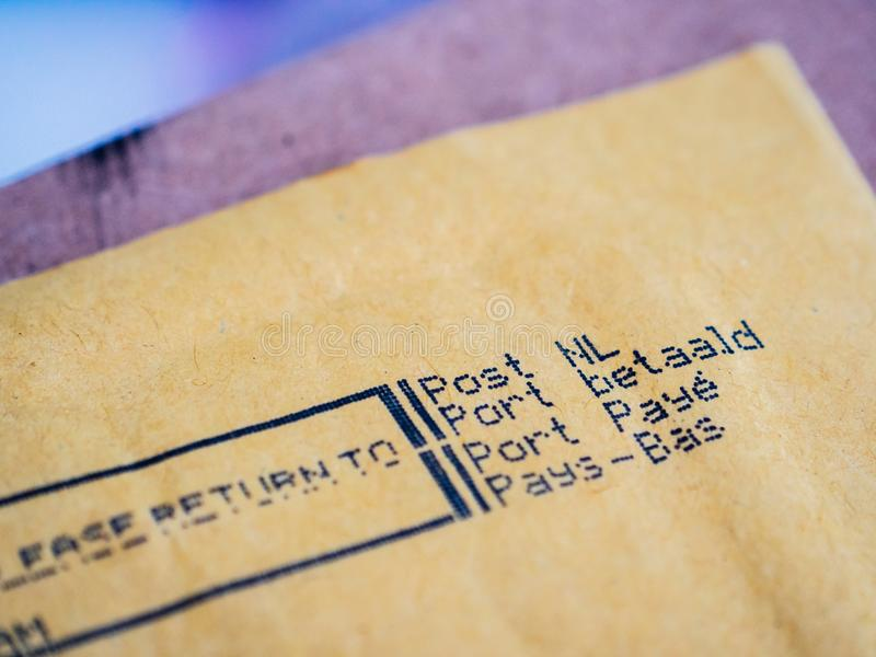 Close-up macro Detail of business envelope from Post NL Netherlands Port Payepostal service with Prioritaire stamp stock images