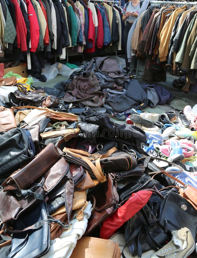 Amsterdam, Netherlands - August 23, 2017: Flea Market with many. Used clothes shoes bags and more stock photography
