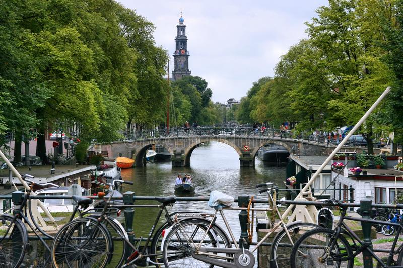 Amsterdam. NETHERLANDS - AUGUST 28, 2008: People visit canal area in . 12.7 million tourists visited The Netherlands in 2013, it was a record visitor number stock images