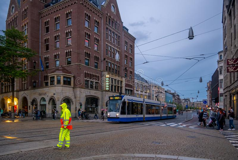 Tram speeding in centre of amsterdam royalty free stock image