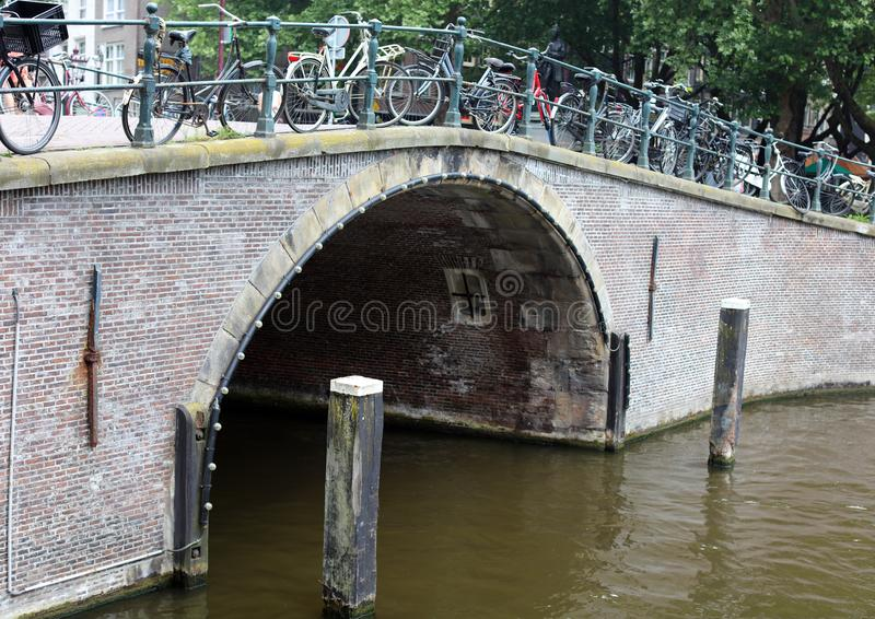 Amsterdam, The Netherlands, city canals, boats, bridges and streets. Unique beautiful and wild European city. stock photo