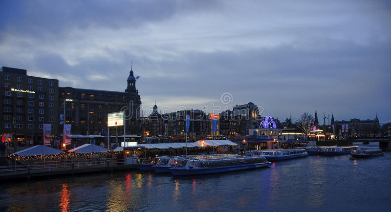 AMSTERDAM, NETHERLANDS - DECEMBER 5, 2015: Boats on the canal in royalty free stock image