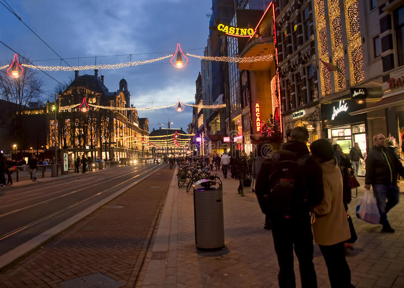 AMSTERDAM, NETHERLANDS - DECEMBER 5, 2015: The main street of th royalty free stock images