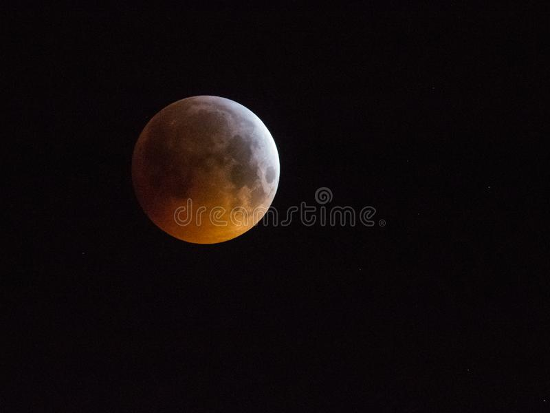 Amsterdam, The Netherlands - January 21, 2019: Super blood wolf moon, moon eclipse on sky stock images