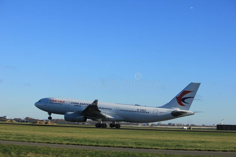 Amsterdam the Netherlands - January 7th 2018: B-5952 China Eastern Airlines Airbus A330-200. Takeoff from Polderbaan runway royalty free stock photo
