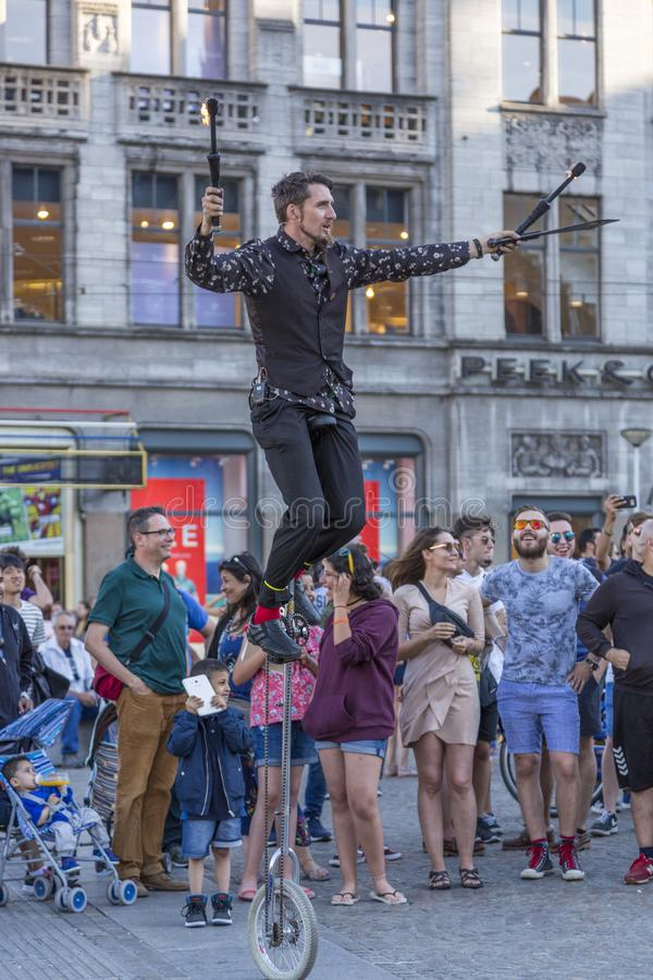 Artists perform in front of the audience in Dam Square. Amsterdam, Netherlands - July 02, 2018: Artists perform in front of the audience in Dam Square royalty free stock photos