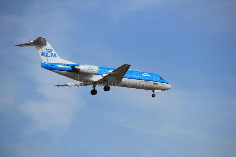 Amsterdam, the Netherlands, July, 21st 2016: PH-KZK KLM Fokker F70. Amsterdam, the Netherlands - July 21st 2016: PH-KZK KLM Cityhopper Fokker F70, approaching royalty free stock images