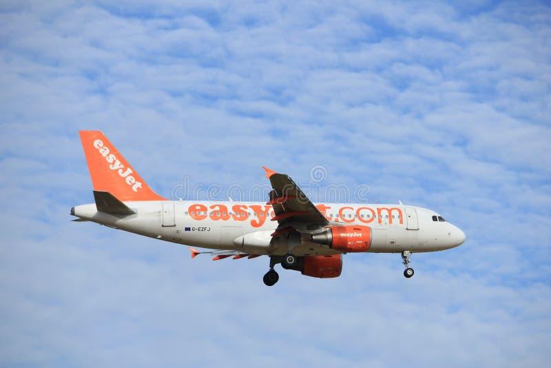 Amsterdam, the Netherlands, July, 15th 2016: G-EZFJ easyJet Airbus A319. Amsterdam, the Netherlands - July 15th 2016: G-EZFJ easyJet Airbus A319 approaching stock image